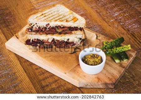Delicious roast beef sandwich with lettuce in restaurant - stock photo