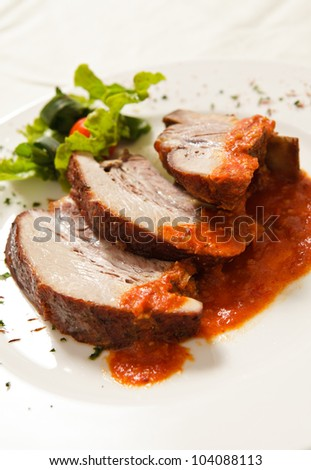 Delicious roast pork spiced with hot sauce. - stock photo