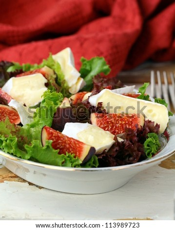 delicious salad with figs and Brie cheese - stock photo