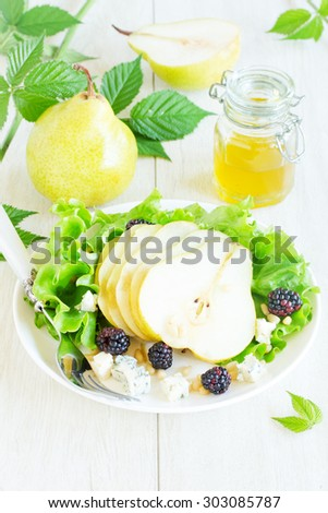 Delicious salad with pears and gorgonzola. - stock photo