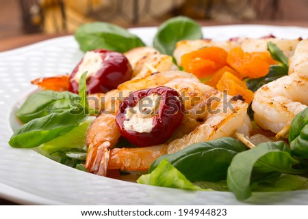 delicious salad with shrimps and red peppers stuffed with goat cheese - stock photo