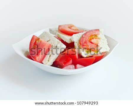 delicious salad with tomatoes, cheese and olive oil - stock photo