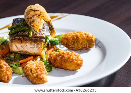 delicious salmon and vegetables meal prepared and presented restaurant style with fresh ingredients - stock photo