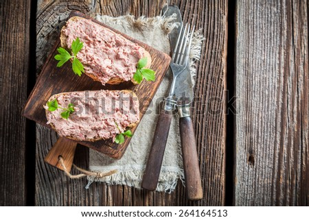Delicious sandwich made of pate with parsley - stock photo