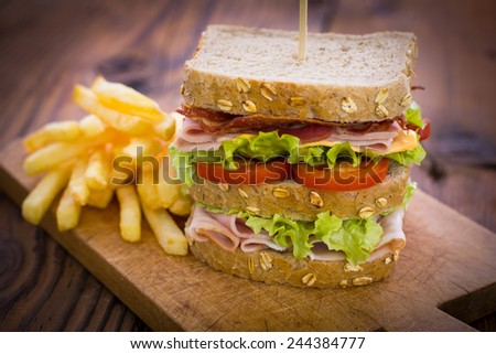 Delicious sandwich on the table - stock photo