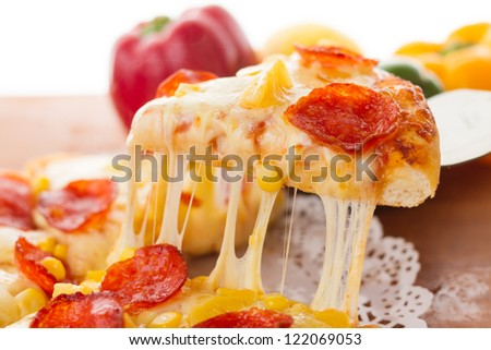 Delicious sausage pizza, on the chopping board - stock photo