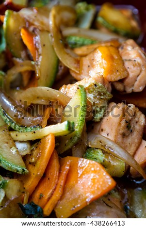 delicious sauted salmon and vegetables meal prepared and presented restaurant style with fresh ingredients - stock photo