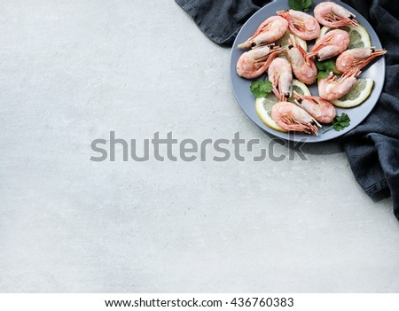 Delicious shrimps with lemon on a dish - stock photo