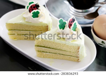 Delicious slice of cake and topping on a plate  background  focus soft 
