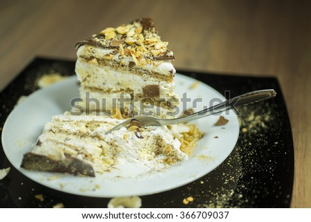 Delicious slice of cake with fork, shallow depth of field - stock photo