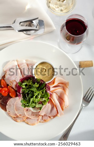 Delicious Sliced Meats with Rocket Salad and Tomatoes - stock photo