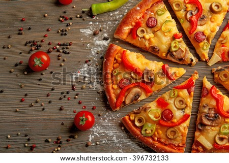Delicious sliced pizza with vegetables, close-up - stock photo