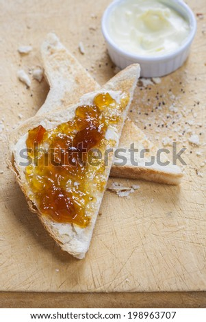 Delicious slices of hot toast with melted butter and marmalade - stock photo