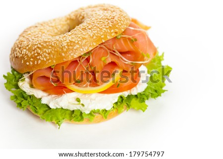Delicious Smoked Salmon Bagel with Sprouts. Selective focus. - stock photo