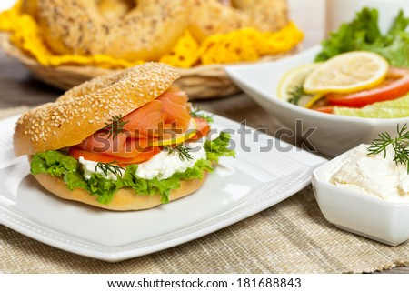 Delicious Smoked Salmon with Bagel. Selective focus - stock photo
