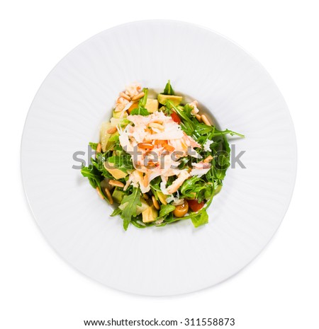 Delicious snow crab salad with pomelo and arugula topped with pine nuts. Isolated on a white background. - stock photo