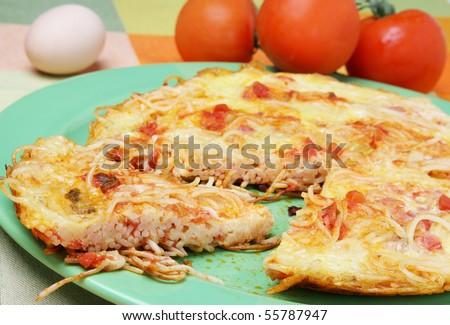 Delicious spaghetti pizza with fresh tomato - stock photo