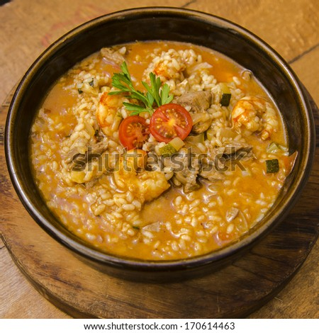 Delicious spanish risotto with meat - stock photo