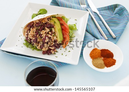 Delicious spicy vegetarian tortilla with hot spices in a bowl. - stock photo