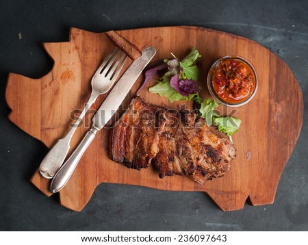 Delicious steak with sauce on board, selective focus - stock photo