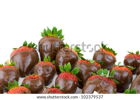 delicious strawberries covered with chocolate in a white plate - stock photo