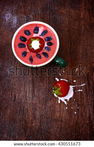 Delicious strawberry dessert with berries on the old brown wooden table. - stock photo