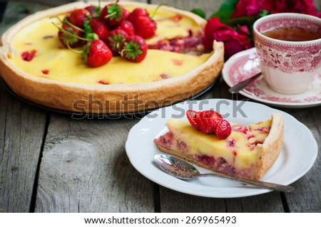 Delicious summery creamy strawberry cake on rustic wooden background, selective focus - stock photo