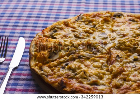Delicious supreme hot pizza with bacon and sweet corn ready to eat - stock photo