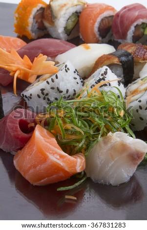 delicious sushi bar close up on black background. - stock photo