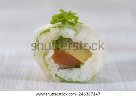 Delicious sushi rolls on white plate with chopsticks and wasabi - stock photo