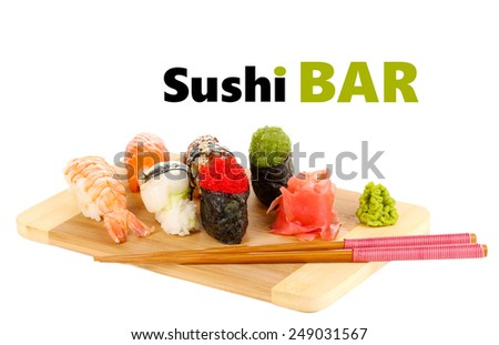 Delicious sushi served on bamboo board isolated on white with space for your text - stock photo