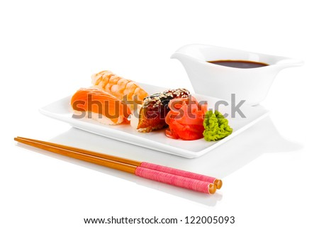 delicious sushi served on plate isolated on white - stock photo