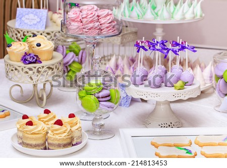 Delicious sweet buffet with cupcakes, Sweet holiday buffet with cupcakes and meringues and other desserts - stock photo