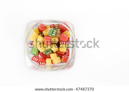 delicious sweet candies in sugar in a glass jar. white background - stock photo