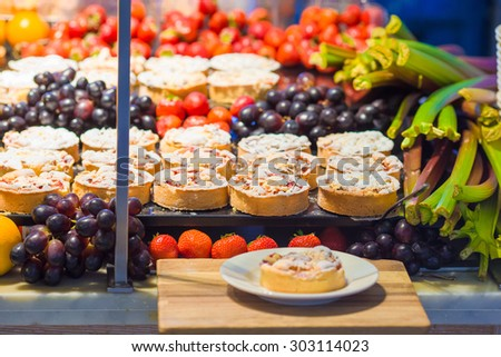 Delicious sweet desserts and cakes in the shop with takeaway - stock photo