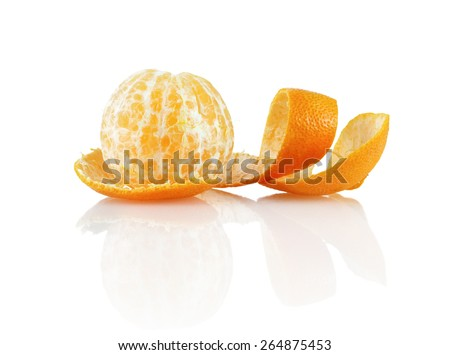 Delicious sweet juicy clementine. Peeled mandarin and peel on a white background with reflection. Isolated on white background. - stock photo