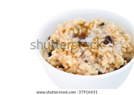 Delicious sweet pumpkin custard rice with brown sugar sprinkled on top. Shallow DOF. Clipping path included - stock photo