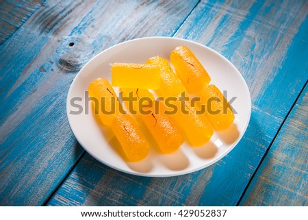 Delicious Sweet Pumpkin Pieces or Dry kesar Petha sweet, selective focus  - stock photo