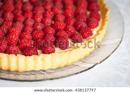 Delicious tart with custard and fresh raspberries - stock photo