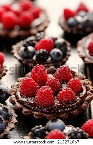 Delicious tartlets with chocolate and fresh berries - stock photo
