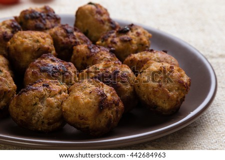 delicious tasty fried meatballs on a brown plate - stock photo