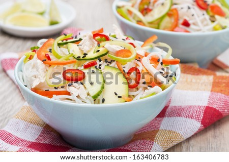 delicious Thai salad with vegetables, rice noodles and chicken, close-up, horizontal - stock photo