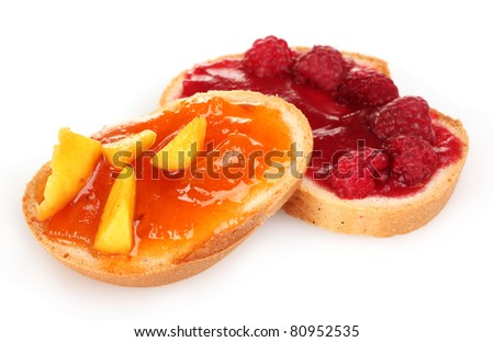 delicious toast with jam and fruit isolated on white - stock photo