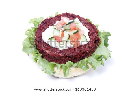 Delicious topless veggie burger with cheese, chopped cucumbers, and tomato. - stock photo