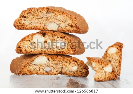 Delicious traditional italian cookie cantuccini detail on white wooden textured background. Culinary sweet dessert eating. - stock photo
