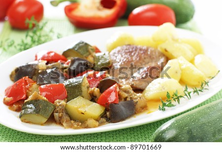 Delicious traditional vegetable ratatouille with stake and potato - stock photo
