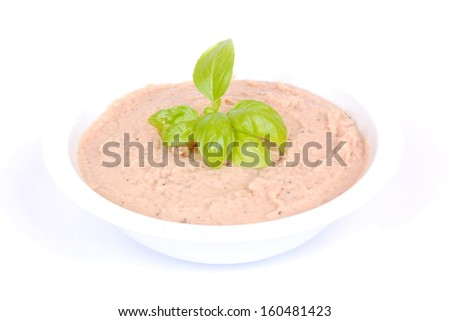 Delicious tuna fish dip garnished with basil leaves in a bowl. Image isolated on white studio background. - stock photo