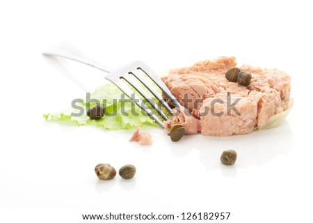 Delicious tuna with capers and lettuce leaf isolated on white background. Culinary healthy gourmet eating. - stock photo