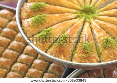 Delicious Turkish sweet, baklava with green pistachio nuts   - stock photo