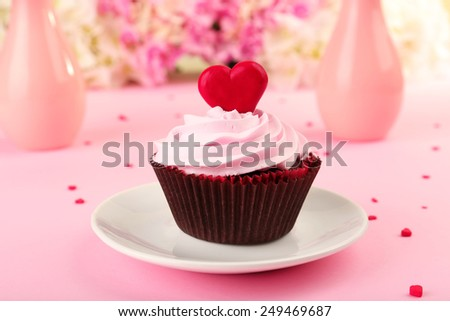 Delicious Valentine Day cupcake on pink background - stock photo